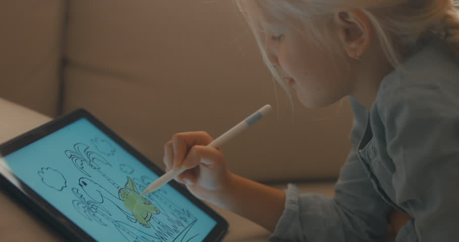 CU Cute Caucasian 5 y.o. girl coloring an image on digital tablet using stylus. Modern interior, evening shot. 4K UHD RAW edited footage #30834253