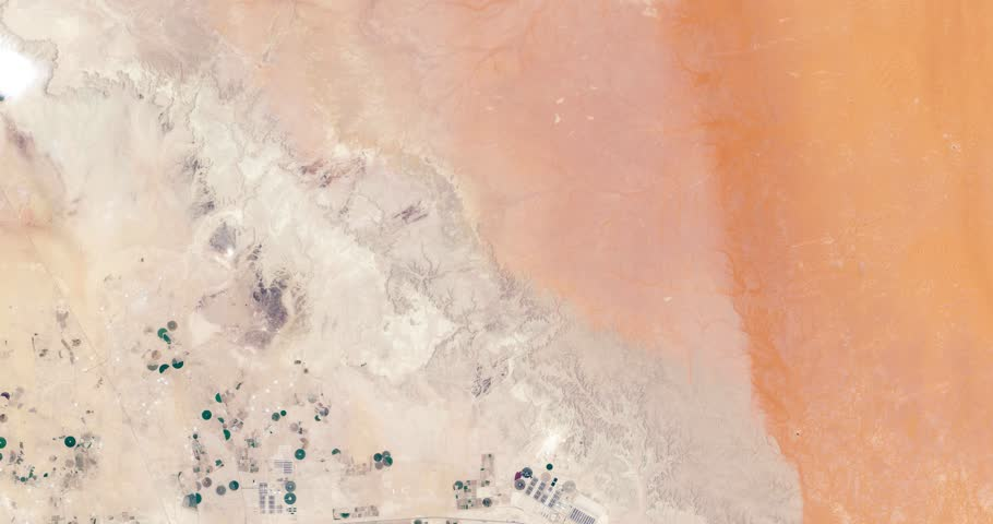 Very high-altitude overflight aerial of Todhia Arable Farm and surrounding land, Saudi Arabia. Clip loops and is reversible. Elements of this image furnished by NASA | Shutterstock HD Video #30843652