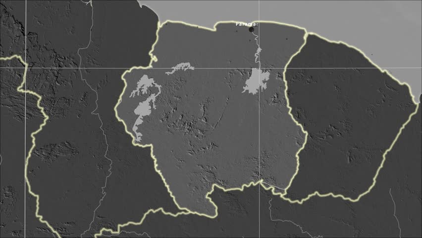 The Suriname area map in the Azimuthal Equidistant projection. Layers of main cities, capital, administrative borders and graticule. Elevation & bathymetry - grayscale contrasted