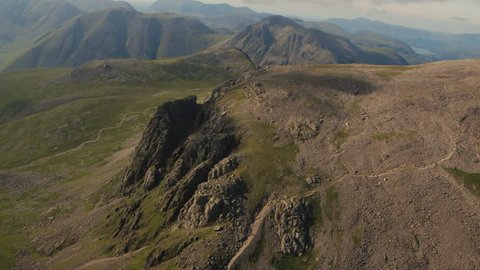 Aerial view of Great Gable with Scafell Pike's crag in the foreground on a clear summer's day.