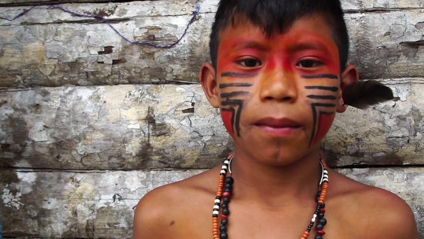 Native Brazilian Boy on a indigenous Tupi Guarani Tribe in Brazil