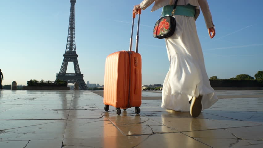 Young Woman with the Orange Suitcase Traveling to Paris. Eiffel Tower Background. | Shutterstock HD Video #30867874