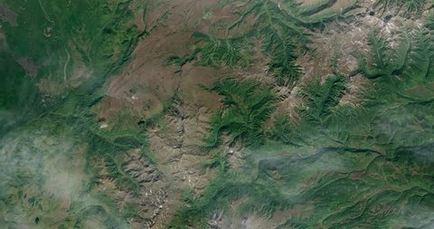 Very high-altitude overflight aerial of volcanic tundra, Kamchatka peninsula, Russia. Clip loops and is reversible. Elements of this image furnished by NASA