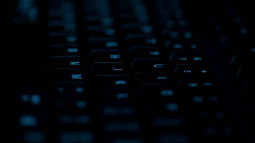 Close up of man hand typing desktop keyboard in the dark in slow motion. | Shutterstock HD Video #30899473