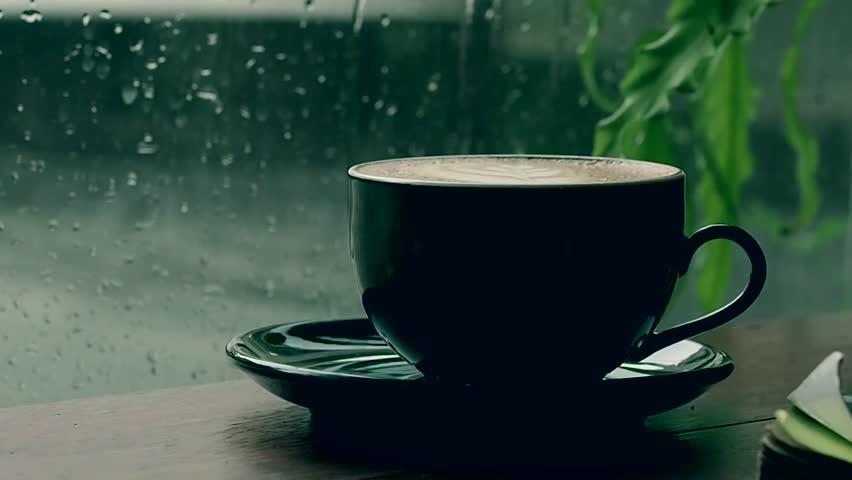 Mug Of Coffee Behind A Window Is Rain In Cozy Coffee Shop Atmosphere