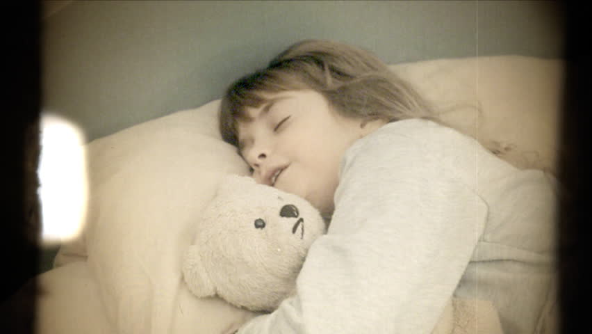 Fake 8mm amateur film: a little girl sleeping in the bed with her teddy bear. Deep sleep. Daylight.