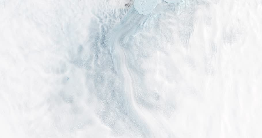 Very high-altitude overflight aerial of the rapidly receding Jakobshavn Glacier, Greenland. Clip loops and is reversible. Elements of this image furnished by NASA