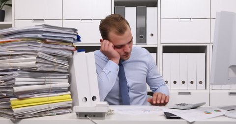 Tired Accountant Man Have Concentration Issues at Office Calculate Tax Documents