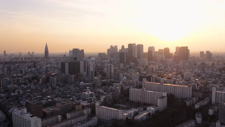 Japan Tokyo Aerial v151 Flying low over Shinjuku area panning cityscape views sunset