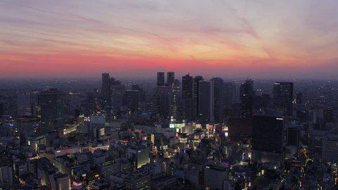 Japan Tokyo Aerial v163 Flying over Shinjuku area panning cityscape views dusk 2/17