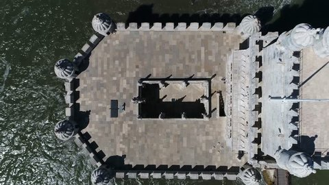 Aerial top down view of Belem Tower Torre de Belem or Tower of St Vincent is fortified tower located in civil parish of Santa Maria de Belem in Lisbon Portugal is UNESCO World Heritage Site 4k quality