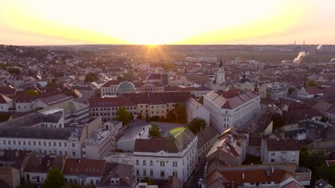Sunrise over downtown Pecs in southern Hungary - aerial video taken by a drone