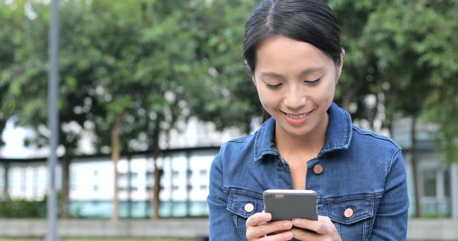 Young woman use of mobile phone  | Shutterstock HD Video #31057243