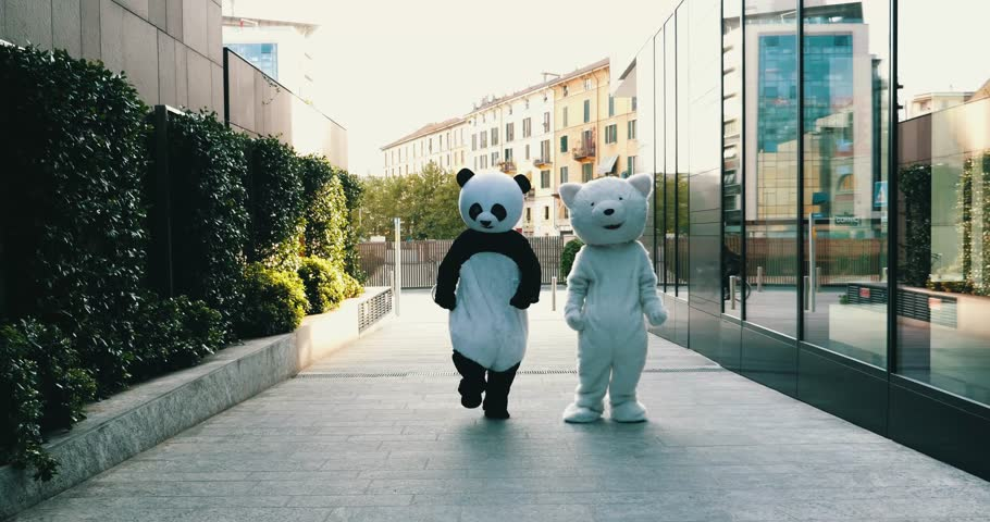 Couple of friends dancing inside big animal costumes | Shutterstock Video #31103923