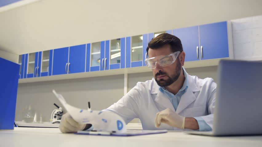 Calm mature professional working on laptop in laboratory | Shutterstock HD Video #31109962
