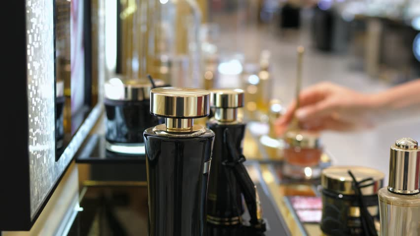 Woman Shopping in Luxury Parfume Boutique Store. Closeup On Parfume. 4K.