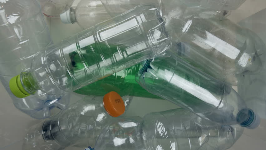 Plastic bottles, recyclable. Tracking shot on top of many recyclables bottles. Recycling concept. 3 out of 3