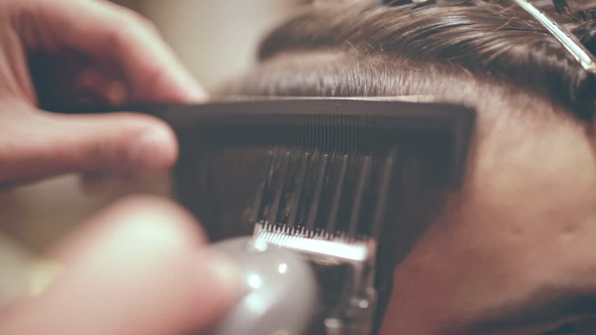 Male haircut with electric razor. Close up of hair trimmer hairstyle. Professional hairdresser cutting hair with hair clipper. Man hairdressing with electric shaver | Shutterstock HD Video #31177903