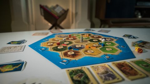 "Board Game ""CATAN"" Stop Motion. The classic ""Settlers of Catan"" board game is set up and animated in time-lapse on a living room coffee table."