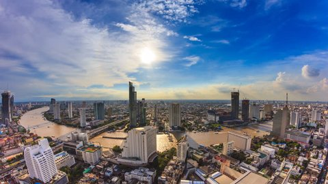 Aerial Bangkok Citysacpe And Chao Phraya River Of Bangkok, Thailand 4K Time Lapse (pan down)