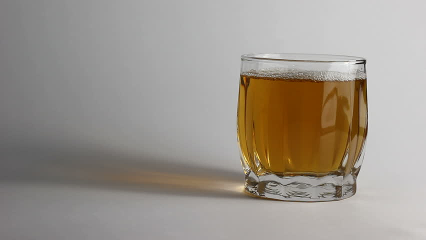Pouring alcoholic drink into glass