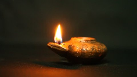 Olive oil clay ancient lantern lamp - flame in motion