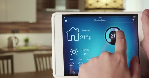 Controlling temperature in the house using app on the digital tablet