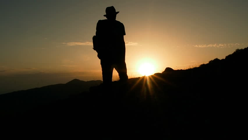 Male Mountain Climber In Summer. Man Hiking in Mountains Enjoying Success. Hiking Walking Slow Motion Recreation Activity. Holiday Vacation Tourism, Outdoors Man Hiking Silhouette  Beautiful Sunset. | Shutterstock HD Video #31242733