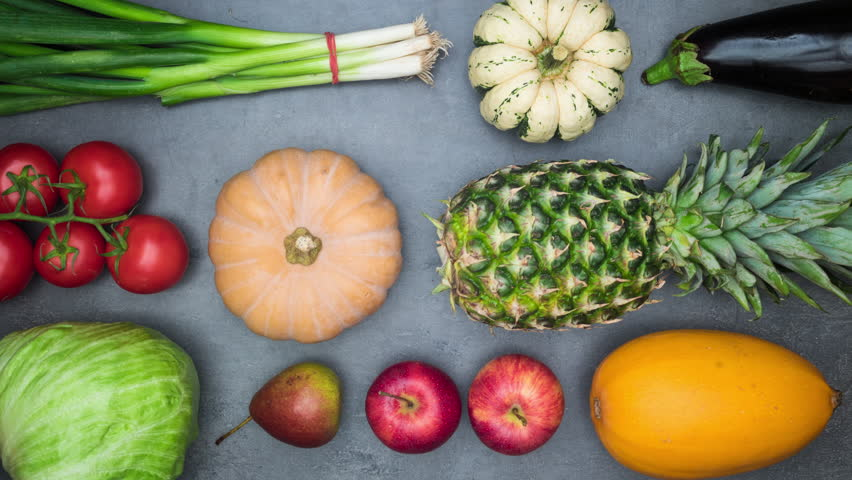 Top view on vegetables and fruits moving on kitchen table. 4k stop motion animation loop.