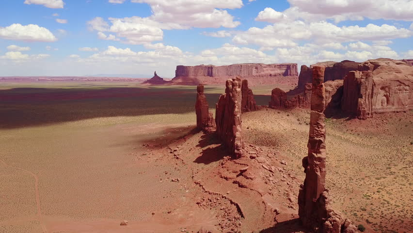 CIRCA 2010s - Monument Valley, Utah - Beautiful inspiring aerial over spires and rock formations in Monument Valley, Utah. | Shutterstock HD Video #31363363