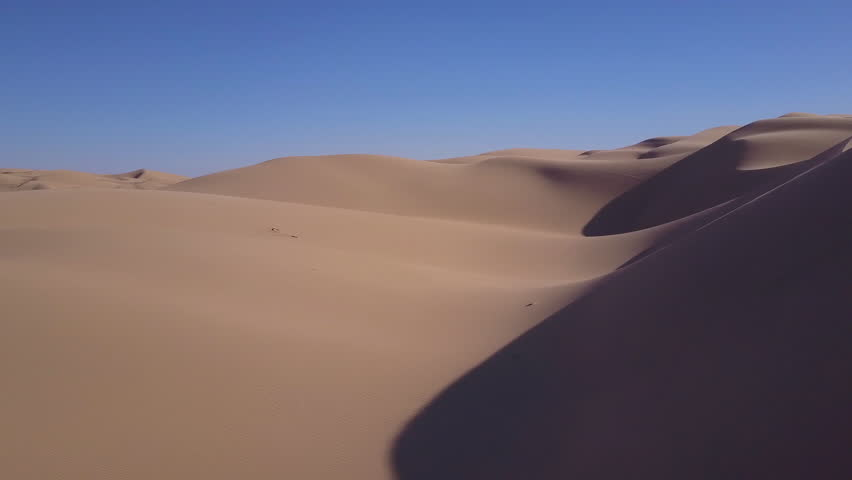 CIRCA 2010s - Imperial Sand Dunes, California - Dune buggies and ATVs race across the Imperial Sand Dunes in California. | Shutterstock HD Video #31373473