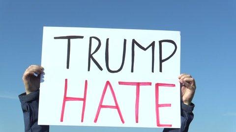 PRAGUE, CZECH REPUBLIC, NOVEMBER 17, 2016: Demonstration against president Donald Trump, banner Trump hate, global climate change, fossil fuels coal oil, czech activist, Europe, European Union