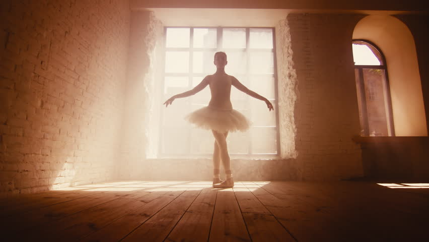 Ballerina training. Female ballet dancer practice in loft style room with big window. | Shutterstock HD Video #31412203