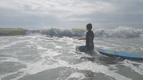Children bodyboarding in ocean waves at Myrtle Beach SC vacation