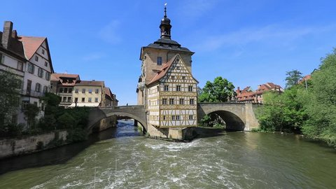 Bamberg. View of Old Town Hall of Bamberg (Altes Rathaus) with two bridges over the Regnitz river, Bavaria, Germany