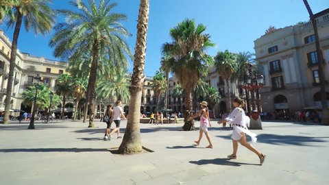 SPAIN BARCELONA JULY 2017: Barcelona Plaza Real, famous square with fountain and palms, tourists walking around beautiful historic buildings.