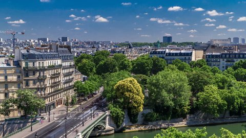 Panorama of Paris timelapse with Bastille column and traffic on road. View from observation deck of Arab World Institute (Institut du Monde Arabe) building. Top aerial view. Green trees, Seine river