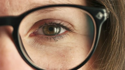 Young Woman pinches the eye with glasses, slow motion
