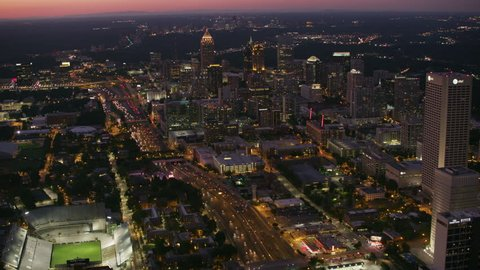 Atlanta, Georgia circa-2017, Aerial view flying over downtown Atlanta at dusk. Shot with Cineflex and RED Epic-W Helium.