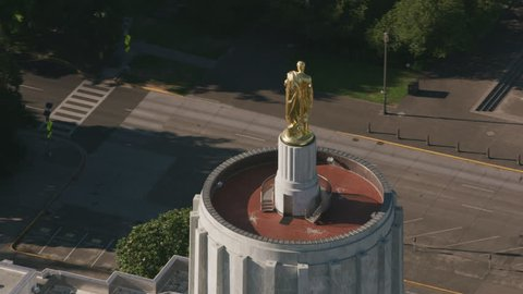 Salem, Oregon circa-2017, Aerial view of golden pioneer on top of Oregon State Capitol Building, Salem, Oregon. Shot with Cineflex and RED Epic-W Helium.