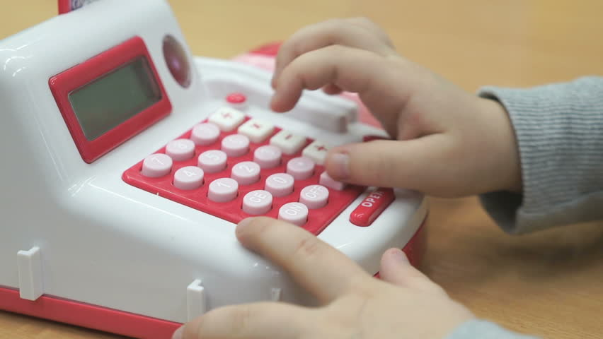 Close up of hands of unknown little child playing and pushing the buttons of toy phone standing on table in the kindergarten | Shutterstock HD Video #31501303
