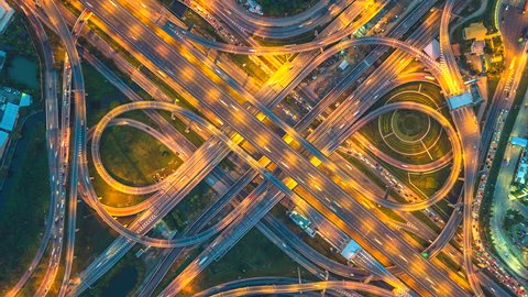 Aerial view Day To Night Time lapse of the expressway, motorway and highway in the detail of circus intersection