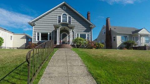 Approaching a small, quaint American suburban home, 4k dolly shot.