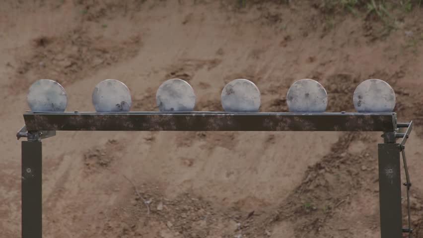 FullHD footage. Metal Target at a shooting range being hit.