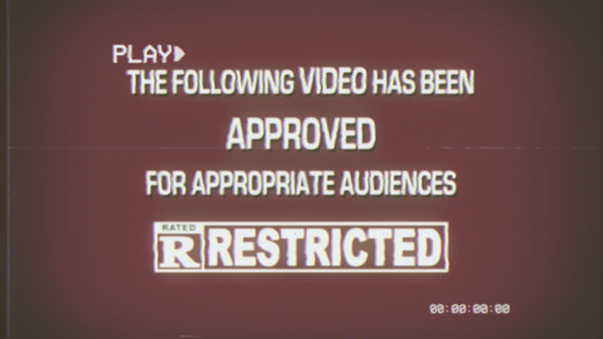 A fake spoof retro vintage aged film leader for a video played on a VHS tape: approved with restrictions, rating R (restricted audiences).  | Shutterstock HD Video #31568653