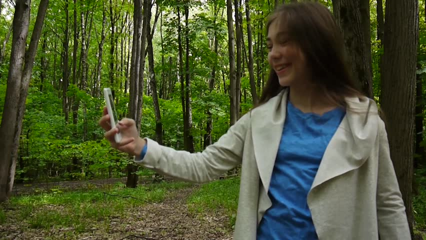 Girl taking selfie photo smartphone at park in summer. Posing and smiling. Video shooting static camera. | Shutterstock HD Video #31622053