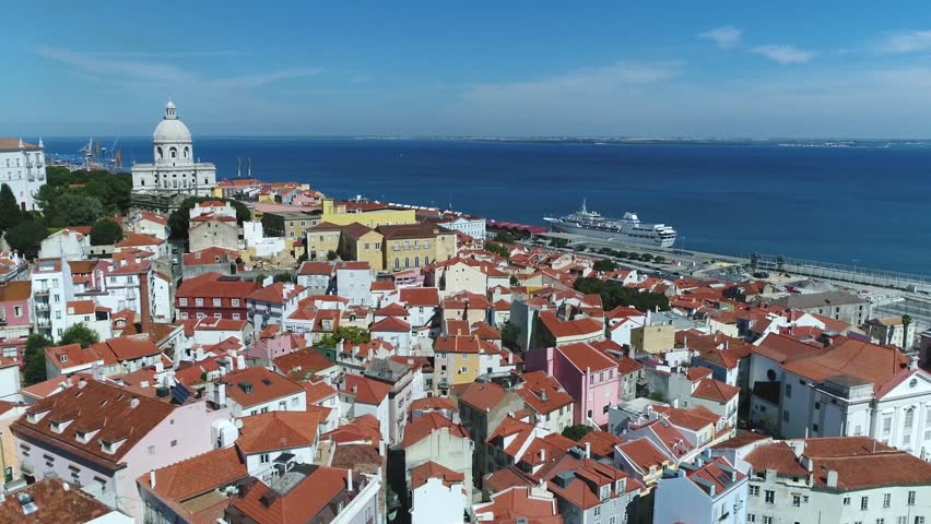 Aerial view Portugal Lisbon the Alfama is oldest district of Lisbon spreading on slope between Sao Jorge Castle and Tejo river its name comes from the Arabic Al-hamma meaning hot fountains or bath | Shutterstock HD Video #31652113