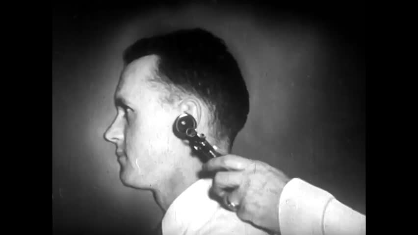 CIRCA 1940s - An otoscope reveals the tympanic membrane of the human ear, in animation, in 1940.