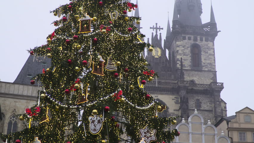 A red Balls Hang On Christmas Tree Among Of Blinking  Garlands  in Old Town Square in Prague | Shutterstock HD Video #31711483