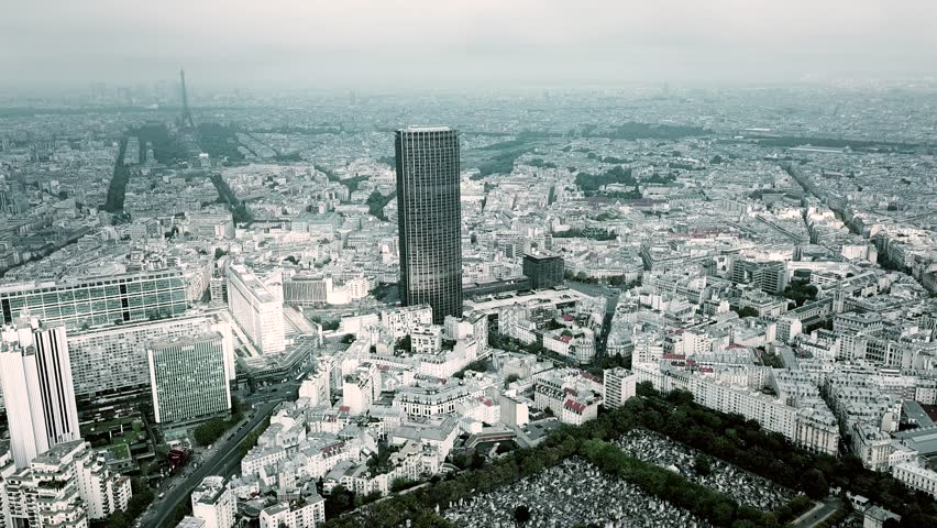 Aerial panoramic shot of Paris cityscape and the Eiffel tower as seen from Montparnasse area on a cloudy day, France